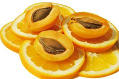 Apricots on orange slices Stock Images