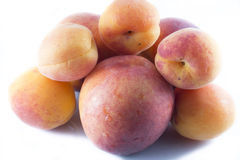 Apricots and peaches on white backgroun Stock Photography