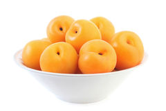 Apricots in plate Stock Photos