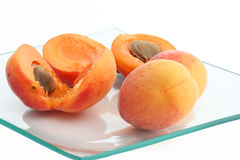 Apricots in a plate. Isolated fresh apricots in a glass plate Royalty Free Stock Images