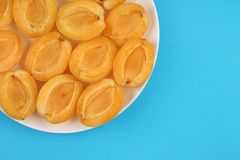Apricots on plate stock image