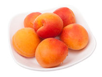 Apricots on plate isolated Royalty Free Stock Photos