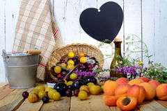 Apricots and  plums on a wooden table Royalty Free Stock Photography