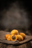 Apricots. Ripe apricots on wooden table Stock Images