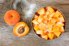Apricots. On rustic wooden background Royalty Free Stock Photo