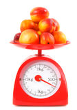Apricots on scales Stock Images