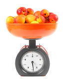Apricots on scales Royalty Free Stock Photo