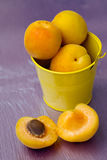 Apricots in a small yellow bucket Stock Image