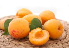 Apricots in a straw cloth Stock Photos