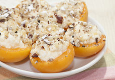 Apricots stuffed. With cream cheese and walnuts Stock Photo