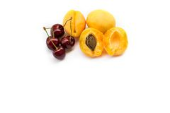 Apricots and sweet cherries royalty free stock image