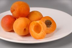 Apricots on a white plate Royalty Free Stock Photography