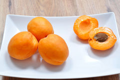 Apricots. On a white plate stock photo