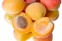 Apricots on white with reflection Stock Photography