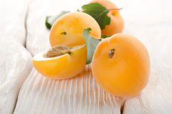Apricots on a white table Royalty Free Stock Images