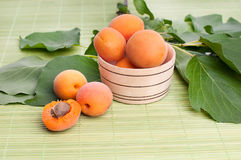 Apricots on wicker coasters Royalty Free Stock Photos