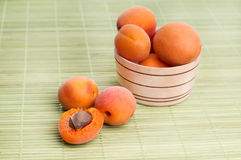Apricots on wicker coasters Royalty Free Stock Photo