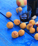 Apricots and wine Stock Photography