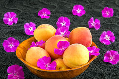 Apricots in a wooden bowl Royalty Free Stock Images