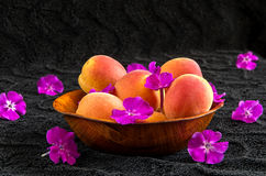 Apricots in a wooden bowl Stock Images