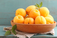Apricots in a wooden plate Stock Photos