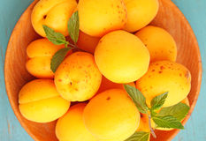 Apricots in a wooden plate Stock Images
