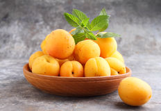 Apricots in a wooden plate Stock Image