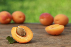 Apricots on a wooden table Royalty Free Stock Photos