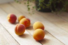 Apricots on wooden table. selective focus Stock Photo