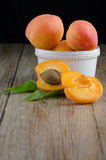 Apricots on wooden table. Royalty Free Stock Photography