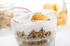 Apricots with yogurt and cereals Royalty Free Stock Photography