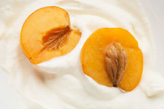 Apricots in yogurt Royalty Free Stock Photography