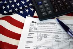 income tax form on American flag Royalty Free Stock Photo