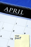 April 15th is the due day for income tax returns. Isolated in blue Stock Photos