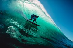 April 18, 2019. Bali, Indonesia. Surfer Ride On Barrel Wave. Professional Surfing At Big Waves In Padang Padang Royalty Free Stock Photo