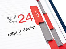 April 24. Notebook calendar open on April 24, with the words Happy Easter royalty free stock photography