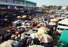 Crowded street with waiting taxis at Kaneshie station, Accrá, Ghana. April, 2018, Accra, Ghana. Kaneshie station is an important transportation hub connection stock image