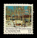 April in Algonquin Park by Tom Thomson. CANADA - CIRCA 1977: A stamp printed in Canada shows april in Algonquin Park, painting by Tom Thomson, birth centenary stock image