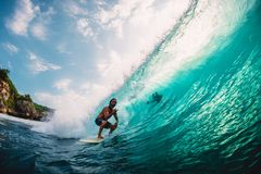 April 18, 2019. Bali, Indonesia. Surfer ride on barrel wave. Professional surfing at big waves in Padang Padang stock photos