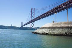 25 of April Bridge, Cristo Rei (Christ King) statue and Tagus river, Lisboa, Portugal Royalty Free Stock Photos