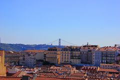 25 of april bridge ponte 25 de abril over the tejo river, seen from the alfama, the old town in lisbon stock images