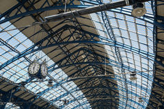 April 2015 - Brighton, England: trainstation at Brighton looking up the roof and clock Royalty Free Stock Image