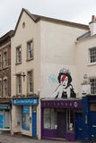 April 2014 - Bristol, United Kingdom: A graffiti of the Royal Queen. With red and blue lightning shaped make to the right closed eye. Colston Street, BH2 8DJ royalty free stock photography