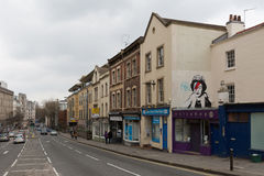 April 2014 - Bristol, United Kingdom: A graffiti of the Royal Queen. With red and blue lightning shaped make to the right closed eye. Colston Street, BH2 8DJ Royalty Free Stock Image