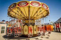 BROOKLYN NEW YORK: Lynn`s Trapeze, a swinging chairs carnival ride awaits riders on a spring day at Luna Park, on. Lynn`s Trapeze, a swinging chairs carnival stock photography