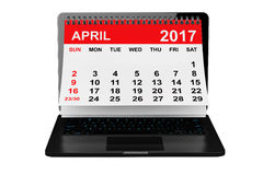 April 2017 calendar over laptop screen. 3d rendering. 2017 year calendar. April calendar over laptop screen on a white background. 3d rendering Royalty Free Stock Photos