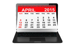 April calendar over laptop screen. 2015 year calendar. April calendar over laptop screen on a white background Royalty Free Stock Photos