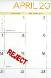 April calendar stamped REJECT on tax day Royalty Free Stock Images
