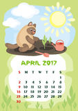 April 2017 calendar. Wall calendar for  April,  2017 with an amusing cat. Fun children`s illustration in cartoon style. Colorful background. Vertical orientation Royalty Free Stock Image