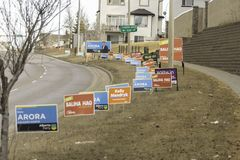 April 7 2019 - Calgary., Alberta , Canada - Candidate campaign signs on road for provincial elections royalty free stock image